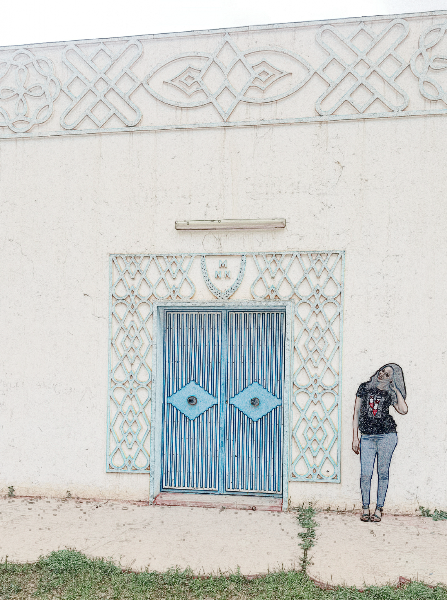 "Standing in front of one of the structures at the ""Musée National Boubou Hama"""