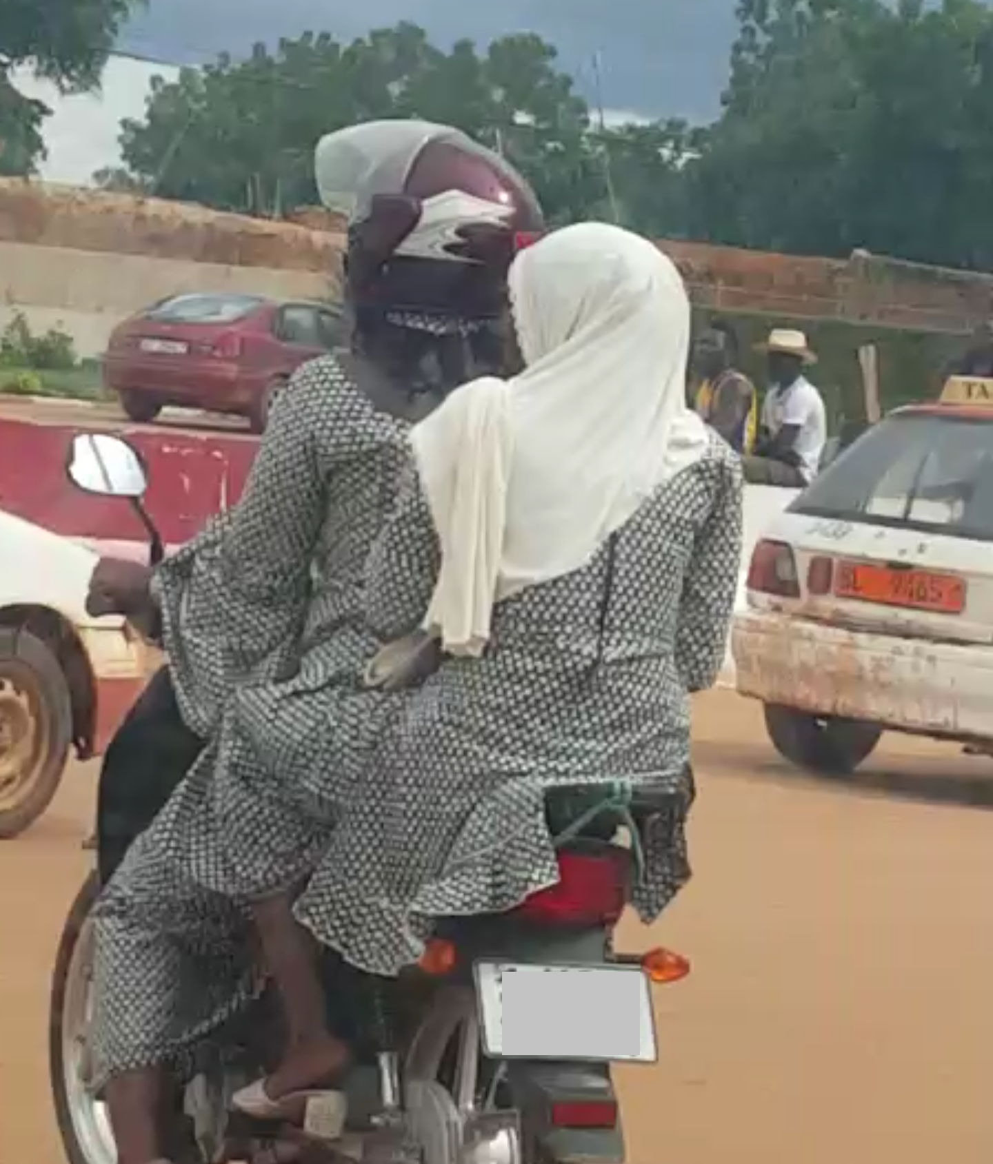 Mother and Daughter (I guess) on a Motorcycle
